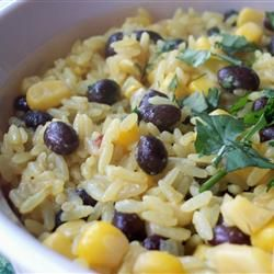 Black Beans, Corn, and Yellow Rice Recipe (I used brown rice) I also added a bunch of chopped fresh cilantro and I used a can of Mexican corn (with pepper) it was delicious