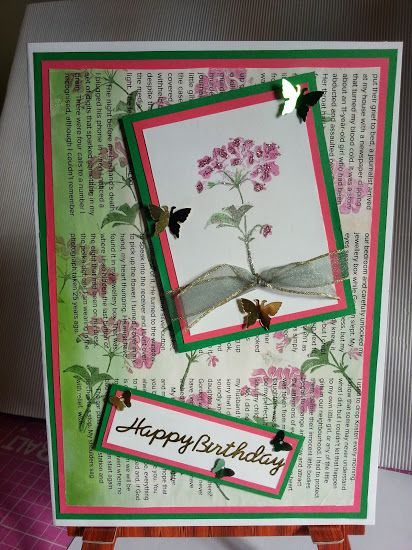 Floral card with newsprint background.