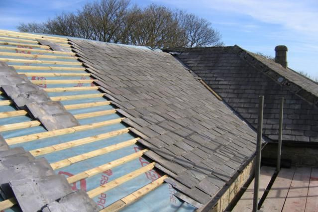 Did You Know: Angle of Your Roof Determines Roofing Materials?: Slate Roof Being Installed