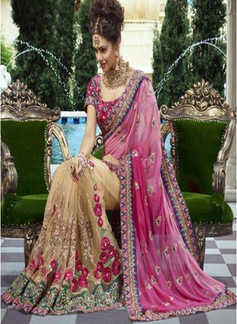 Impressive bridal #saree in pink color shaded faux georgette pallu and beige color net skirt part with glorious patch work #designersares #clothing #fashion #womenwear #womenapparel #ethnicwear