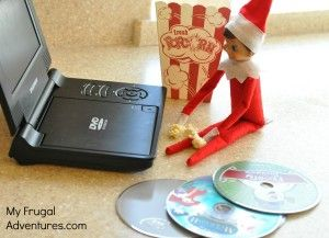 "Elf on the Shelf loves movie night and so do the girls....He was up most of the night selecting our next movie for ""Movie Night""...."