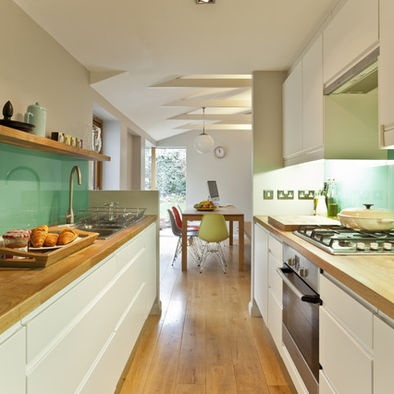 Galley Kitchen Design, like the wooden bench tops with white cupboards and green splashback