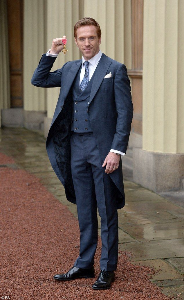Looking sharp: The actor looked debonair in a navy blue suit and shiny black shoes for the occasion