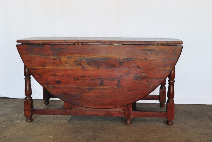 #NorthcliffAntiques #Lounge Furniture large Tambotie wood gate-leg table with baluster turned legs joined by stretchers. This beautiful, rich reddish brown wood is incredibly heavy. Endangered in South Africa, it has been said by a certain Prof. Otto to have been traditionally used in the making of huts because ants won't eat the frame. #Johannesburg #SouthAfrica #Furniture