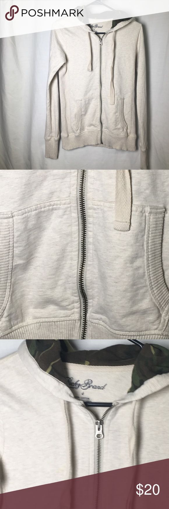 Women's lucky brand zip up hoodie jacket Lucky brand zip up hoodie jacket. With drawstring pull to tighten hood. The jAcket is a light beige color and the inside of the hood is camo green design. Size small. Lucky Brand Jackets & Coats