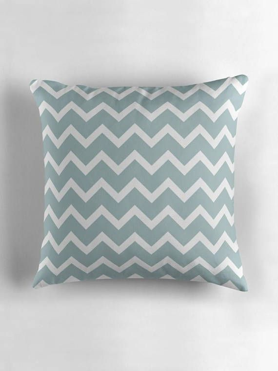 Duck egg blue cushion This is a beautiful cushion cover produced an original design by Shadowbright. The cushion has beautiful colours of duck egg blue and white. The cushion has a simple chevron design and is part of my Memphis style collection. There are other products
