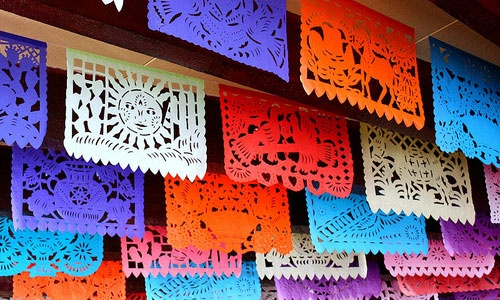 Papel picado.  Mexican decoration for streets, restaurants, parties.  Color.  Design.  Positive and negative space.