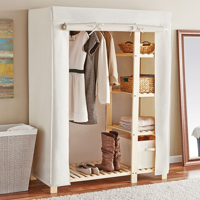 NEW and Available now is our Wooden Wardrobe! To see more: https://www.tidyliving.com/wood-wardrobe-with-4-shelves-and-canvas-cover.html #TidyLiving #Closet #Storage #Wood #Inspiration #Organize
