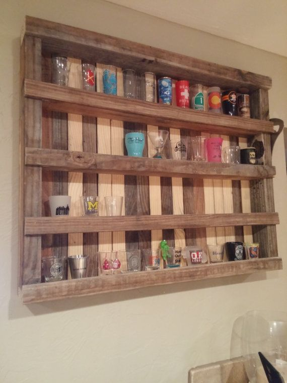 This 29 inch × 24 inch rustic, reclaimed wood is the perfect display for shot glass collections, spices, etc. Custom sizes available.