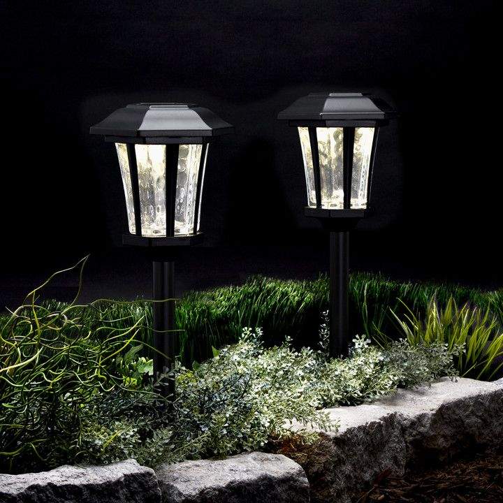 This set of four traditional path lights feature a durable, weather-resistant black metal exterior and bright LED illumination. Powered by the sun, the lights recharge throughout the day and automatically turn on at dusk providing a warm glow well into the evening.