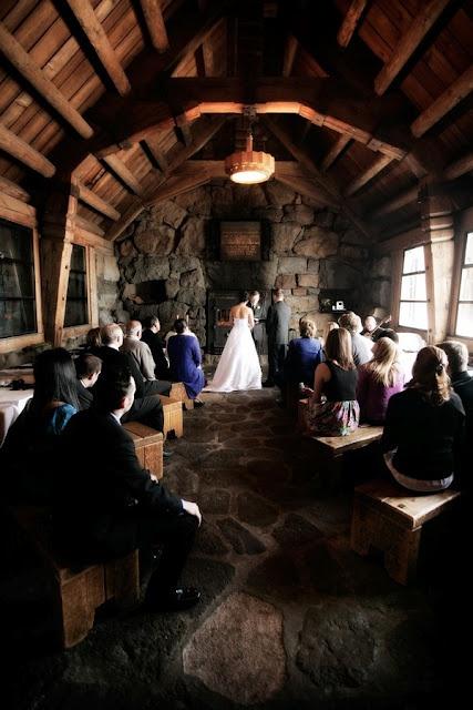this is just SOOO amazing! Cabin rustic barn wedding pews wood ceremony