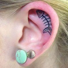 Fish Bones in Ear Tattoo Small fish bone tattoo in inner ear - Download