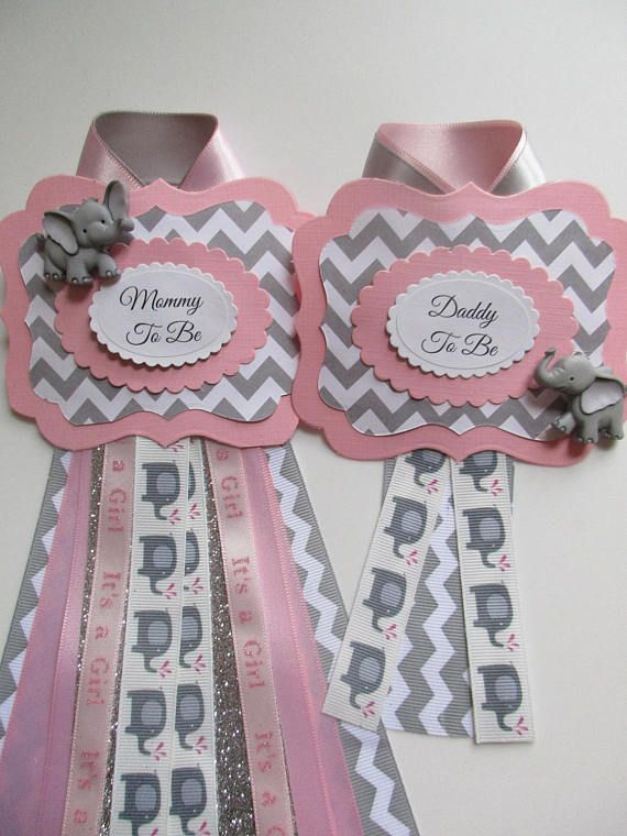 SET-Mommy/Daddy To Be Elephant Baby Shower Corsage Set. Perfect for that Special Mom and Dad To Be. Comes with a Brooch style pins. Made with ribbon, card stock, elephant embellishments and name tags. Need one for grandma/grandpa, aunt, big sister/brother just message me. Will ship in 5-7 business days. If you need sooner, please let m know. Can customize to any theme, just ask. Can be made for a baby boy too! Can be made in other colors, please ask. moms corsage is 4 x4x 7 inc...