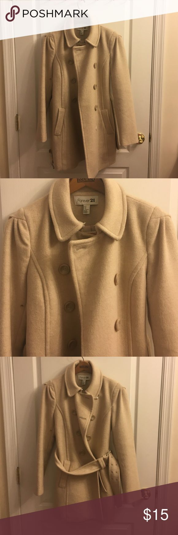Forever 21 cream jacket This forever 21 jacket is in a cream color with light-marbled buttons. It also has a removable belt for cinching the waste. It has been worn 1 or 2 times. I am 5 7 and it hits halfway between hips and knee. Forever 21 Jackets & Coats Pea Coats