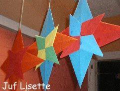 Kerststerren gemaakt van vouwblaadjes. (www.juflisette.nl)