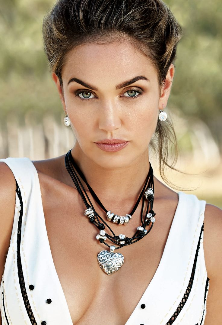 #migliostyle - N1572 Black #leather #necklace with twist-and-turn elements and #classic #Swarovski crystals layered wiith N1100 Petite versatile black #silk cord #necklace with burnished #silver #rings and classic #Swarovski #crystal worn with EN985 burnished silver #heart #pendant with appliqué detail and dotted with classic #Swarovski #crystals - www.miglio.com