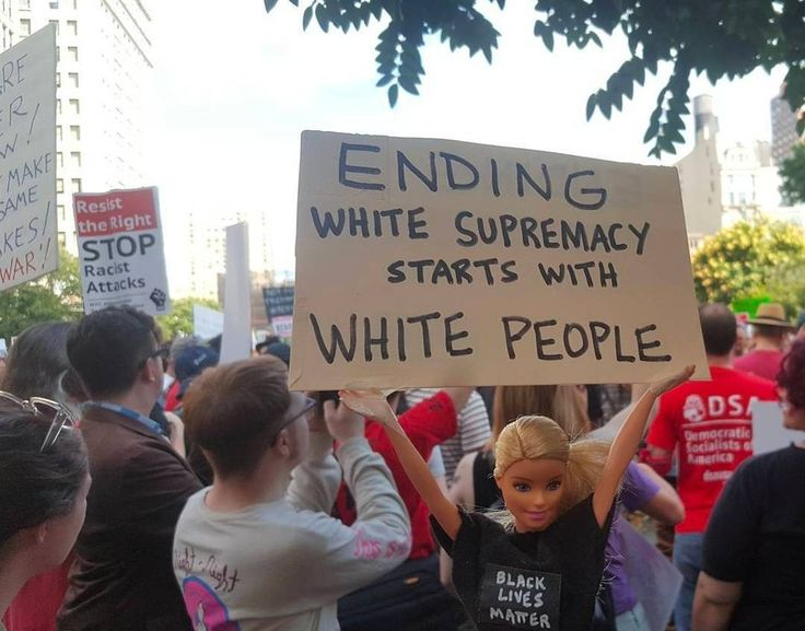 """ENDING white supremacy starts with white people,"" at an anti-Trump, anti-racism march, August 2017.  Photo credit: Judah Friedlander — in Manhattan, New York."