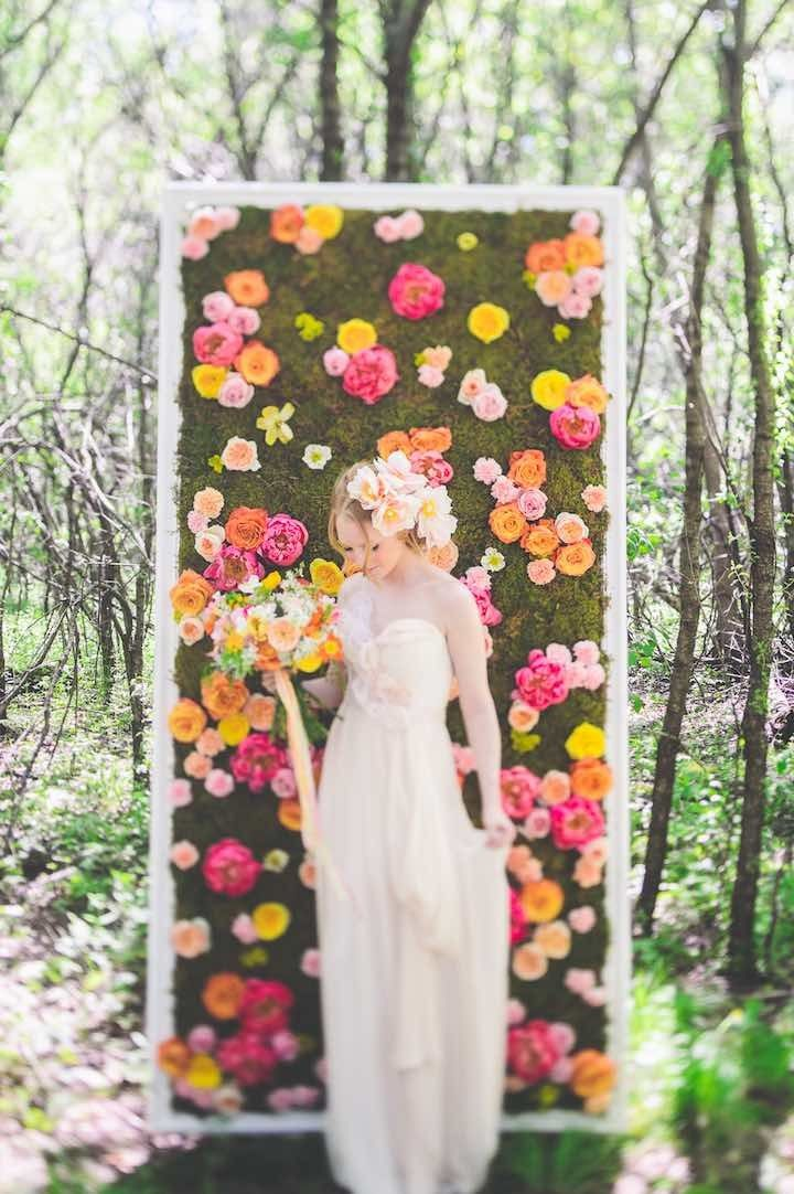 flower board backdrop at wedding reception; photo: Paper Antler