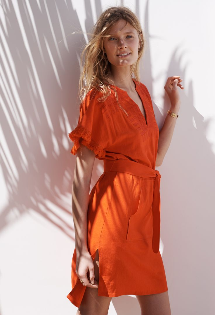 madewell paradise embroidered dress worn with the arrowshift cuff.
