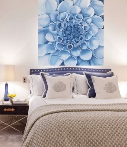 Don't be afraid of oversized art in the bedroom! This giant blue dahlia painting is visually connected to the headboard, while also making the space feel bigger.
