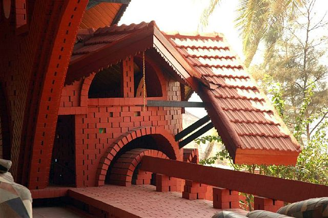 Korlai Bungalow: Exterior view of the arcade of the pavilion, viewed from within the pavilion.The stairwell opening, under a projecting roof, is visible at left   Archnet