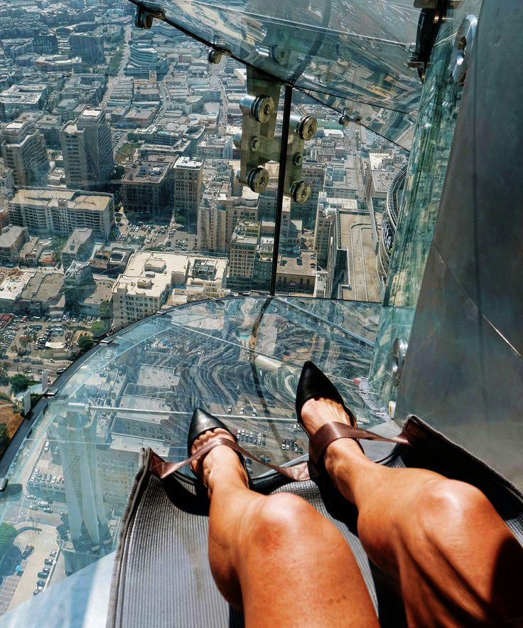 Los Angeles Skyscraper Slide | Los Angeles has a new slide on the OUE SkySpace L.A. observation deck that hovers 1,000 feet above ground. #refinery29 http://www.refinery29.com/2016/06/115044/los-angeles-skyscraper-slide