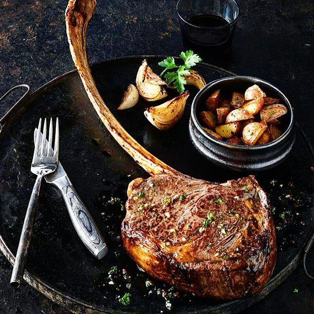 Incredible. Cowboy-cut. Garlic & Herb-encrusted. Tomahawk ribeye steak with fire-roasted  potatoes and caramelized shallots. #likeaboss #myfoodeatsyourfood  . Courtesy: Allen Brothers Steaks | @absteaks . . . . . Blog: http://ift.tt/1vCV6pv  #chef #grill #grilling #bbq #barbecue #parrilla #asado #backyardbbqhero #beef #beefitswhatsfordinner #beer #prime #meat #meatlover #carnivore #paleo #glutenfree #feast #instagood #foodstagram #foodgasm #foodpics #steak #steakporn #getinmybelly…