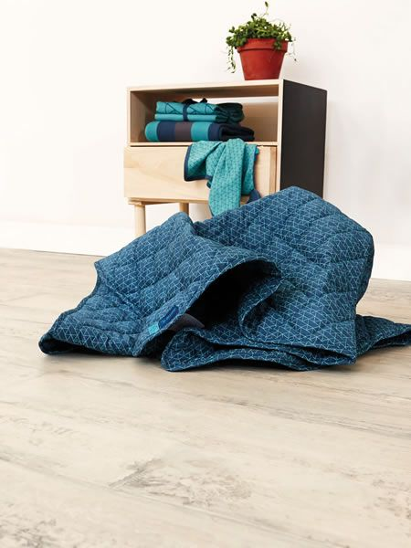 NEWBORN by name it - colorful babyaccessories such as blankets, bedding and cuttle coths.
