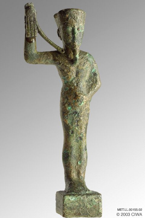 "Fig. 2 Statuetta in bronzo del faraone Amenhotep III "" Amenhotep III as Amun-Min, bronze statuette. Egypt, New Kingdom, Dynasty 18, Amenhotep III//Nebmaatre, Luxor, Bronze, h =18.8 cm"" (Virtual Egyptian Museum)."