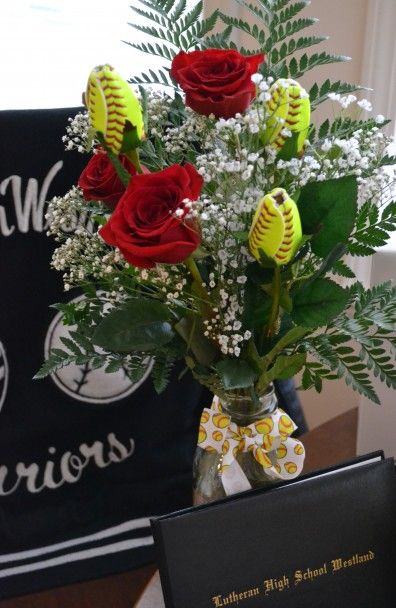 On display at our daughter's graduation celebration are her Varsity jacket (Lettered 4 yrs for softball), her diploma and her sports rose bouquet.