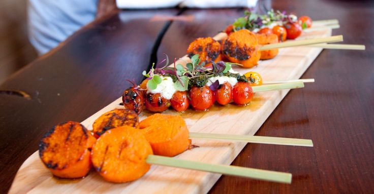peruvian street food @ picca- skewered roasted sweet potato, roasted tomatoes topped with burrata and black pesto