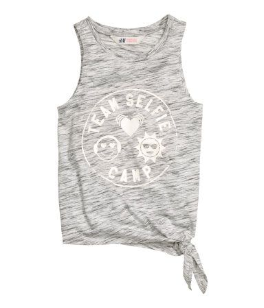 Sleeveless top in cotton-blend jersey with a print motif and tie at one side.