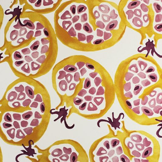 Pomegranate Fabric A curtain fabric designed by Emma Bridgewater inspired by the rich exotic colours of pomegranates observed in an Istanbul street market. Printed in lion yellow and pink on a cream ground.