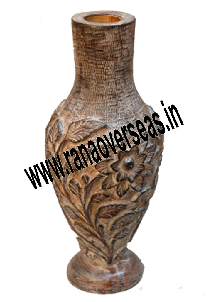 Rana Overseas leading manufacturer, exporter and supplier of Wooden Flower vases.  Wooden flower vases designed by artist beautifully showcase the traditional as well as modern designs. Wooden Flower vases are designed in styles ranging from exquisite to outrageous ones. These Flower vases chiseled out of variety of materials in varied shapes are extremely eye-catching with their compelling beauty. The Wooden flower pot base is made heavy to provide support to its body.