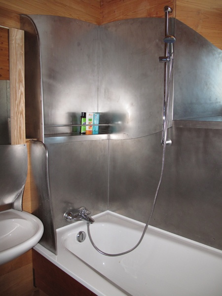 Sheet metal shower interior. no tiles, no cracks, no water enters ...