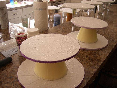 Cupcake / Centerpiece Stands. We could totally make these!!