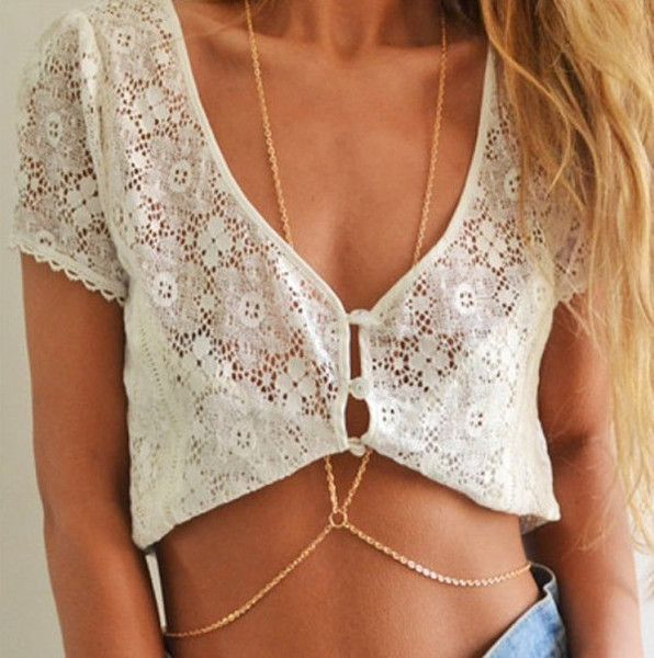- Stylish waist belt body chain necklace - Unique design offers a cool edgy look - Playful design perfect for any occasion - Chain Material: alloy