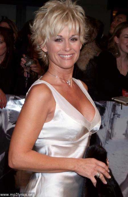 25 Short Hairstyles for Older Women Lorrie Morgan Style and cut.