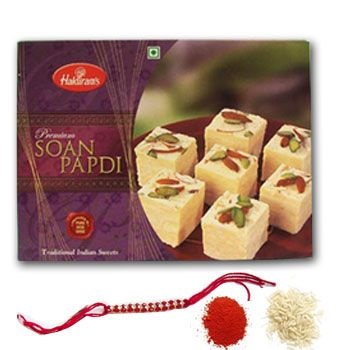 Rakhi festival is all about love and duty between brothers and sisters. On this colorful occasion you can wish your brother by sending Rakhi Combos Home Delivery with a red and simple rakhi of stones attached in the middle of it. With this simple rakhi you can present him soan papdi to make his day memorable and roli chawal through Shop2Ap.com