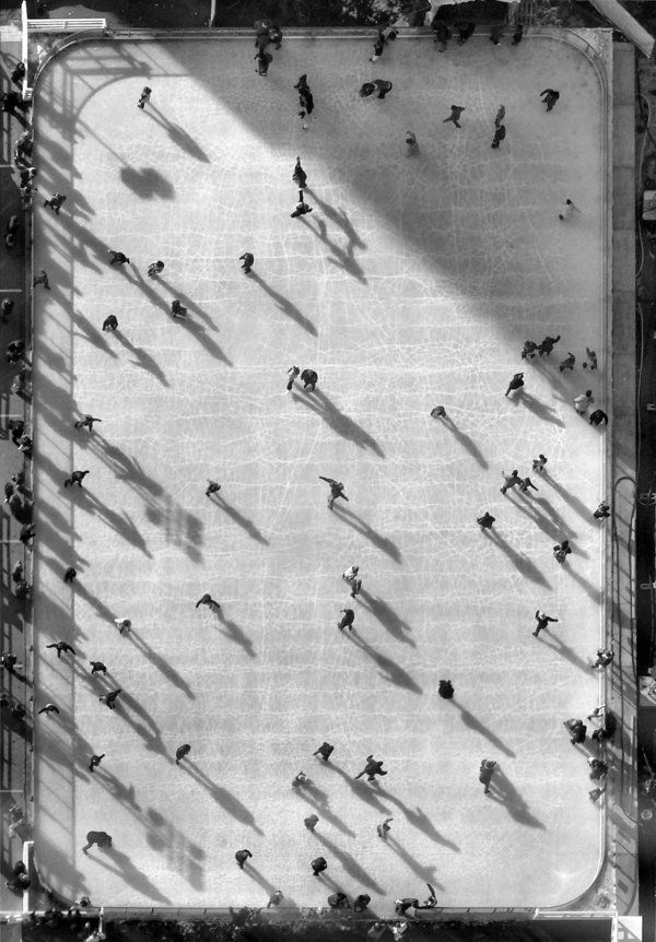 The open-air skating ring viewed from the 52-nd floor of Tour Montparnasse, Paris. Shot through the window glass.