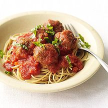 Super–Easy Spaghetti and Meatballs v 	 1 pound(s) uncooked 93% lean ground beef    1/4 cup(s) dried plain breadcrumbs    1/4 cup(s) grated Parmesan cheese    	 1 large egg(s)    1 1/2 tsp Italian seasoning    1 1/2 tsp kosher salt     	 3/4 pound(s) uncooked whole-wheat spaghetti    24 oz bottled reduced-fat pasta sauce    1/4 cup(s) basil, fresh, chopped