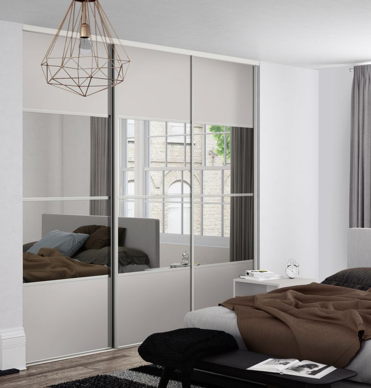 Classic 4 panel sliding wardrobe doors in Cashmere and Mirror finish with Silver frame.
