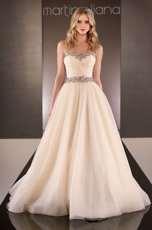This tulle wedding dress has a figure flattering twist for Wedding dresses for larger figures