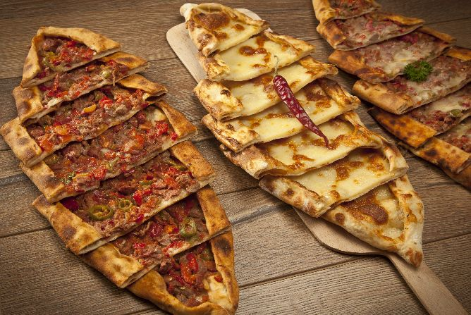 Pide pastry with either minced meat cheese or minced for Authentic turkish cuisine
