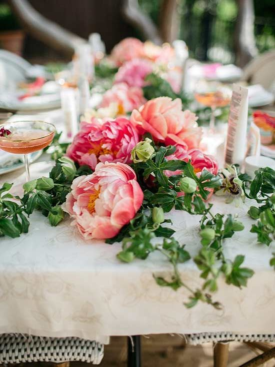 If you're like us, then the peony is one of your favorite garden flowers. Peonies are stunning as wedding flowers, in a vase, or growing in the garden. Here is how to incorporate peonies into centerpieces and bouquets with ease.