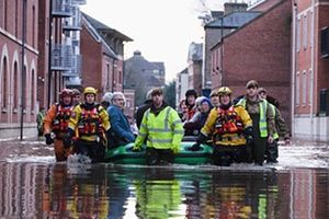 Members of Cleveland Mountain Rescue and soldiers from 2 Battalion The Duke of Lancasters Regiment assist members of the public as they are evacuated from the Queens Hotel in York city centre.