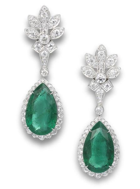 A pair of emerald and diamond pendant earrings Each set with a pear-shaped emerald, within an old brilliant-cut diamond surround with millegrain detail, to a similarly-cut miligrain-set diamond foilate surmount, mounted in platinum, the emeralds estimated to weigh approximately 15.50 carats in total, the diamonds estiamted to weigh approximately 2.20 carats in total, earring length 4.5cm