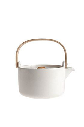 Oiva teapot designed by Sami Ruotsalainen for Marimekko. It's lovely—white porcelain with bamboo fixtures, and a very convenient tea strainer inside. Dishwasher/freezer/microwave-safe. $89
