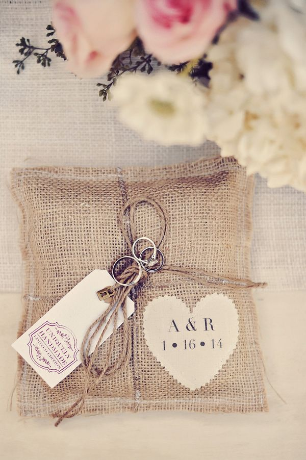 burlap ring pillow, photo by Tamiz Photography http://ruffledblog.com/haiku-mill-wedding #weddingideas #ringpillow