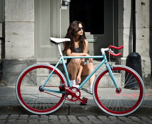baby blue turquoise fixie bike red wheels white saddle fixie girl